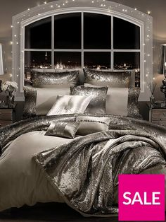Kylie Minogue Mila Duvet Cover in Double, King and Super King sizes Create a real impact in your bedroom with this stunning duvet cover from the Mila range by the pint-sized princess of pop Kylie Minogue. Luxurious sheets in a sumptuous shade of praline play host to scores upon scores of sparkling sequins, fading from a rich creamy hue to a soft silvery-tone. The 100% cotton reverse gives it a wonderfully soft finish that you'll love snuggling under. Match with other items in the collection…