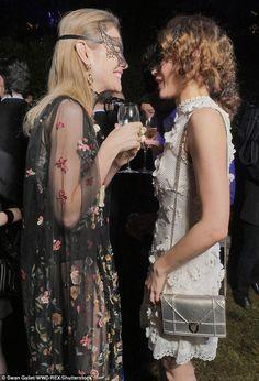Chatting away: Russian beauty Natalia and former Bond girl Olga got better acquainted