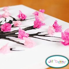Twigs and tissue paper blossoms! These would be so cute in a vase :0)