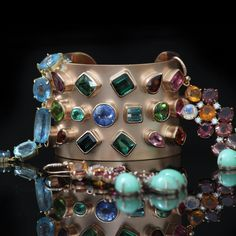 Brand New Irene Neuwirth cuff at Marissa Collections. Aquamarine bracelet, sapphire fire opal and mint chrysoprase earrings.