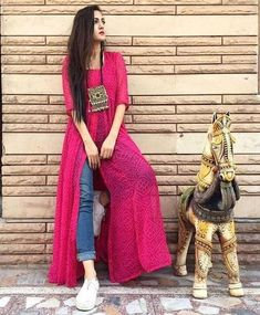 This post features New trendy ways to wear kurti with jeans and explore how to wear slit, short, long kurti and peplum with jeans. Dress Indian Style, Indian Dresses, Indian Outfits, Kurti Designs Party Wear, Kurta Designs, Indian Designer Outfits, Designer Dresses, Indian Designers, Stylish Dresses