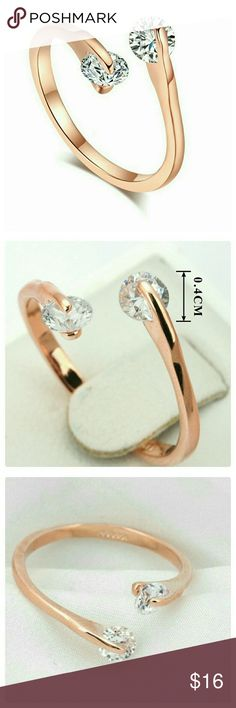 JUST IN: 18K RGP Twin CZ Ring NWT Metal: Zinc Alloy. 18K Rose Gold Plated. AAA+ Austrian Round CZs. Prong Setting. CZ size: aprox 4mm. Brand new with tags. Size: 7.25.   MORE SIZES COMING SOON! Jewelry Rings