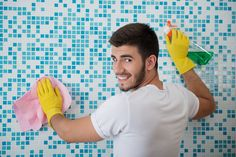 Half-length portrait of young smiling dark-haired janitor wearing white shirt and yellow rubber gloves standing back in the bathroom and cleaning it with the rag and detersive photo Royalty free images stock Royalty Free Images, Royalty Free Stock Photos, Cleaning Gloves, Rubber Gloves, Interior Photo, Model Release, Photo Editing, Create Yourself, Portrait