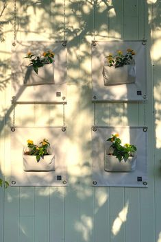 Crisp white hanging planter Pockets with live plants hanging on a whitewashed barn wall. Great idea to hang the Pockets on chains and clip them together Plant Bags, Garden Bags, Hanging Planters, Live Plants, Chains, Crisp, Barn, Bloom, Pockets