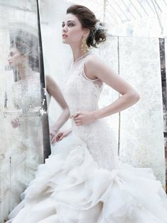 Description: Style:LZ3253 Ivory organza flounce bridal ball gown, sweetheart neckline with jewel neck tulle overlay, sheer corseted Alencon lace elongated bodice, layered asymmetrical organza skirt, chapel train