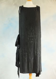 This beautiful fully lined black silk dress in great strong wearable condition from 1920's Paris has a label, 'Aine Montaille Paris.' This very smart store was situated at 1 Place Vendome, Paris.