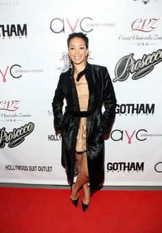 Even when peaking out of a black coat, Gloria Govan's custom-made Daisy Gonzalez dress stands out. Ultra-feminine and leg-bearing!