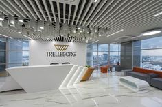 Trelleborg Office Layout- space iconic yet simple Zyeta Studios has developed the new offices of engineered polymer solutions company Trelleborg AB located in Bangalore, India. Being the group that… Corporate Interiors, Office Interiors, Reception Counter Design, Office Reception Design, Reception Desks, Lobby Design, Office Table, Office Interior Design, Commercial Design