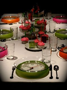 (Dollar Store) Clocks under glass plates are the main attraction at this tabletop for a New Year's Eve dinner.