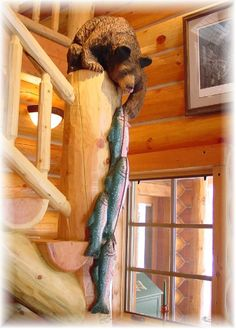 Rustic living ~ cabin decor~ and who ever carved those details, bear, fish ~ they have a great talent and gift . Log Cabin Living, Log Cabin Homes, Log Cabins, Bear Decor, Wooden Cabins, Cabin Interiors, Lodge Decor, Cabins And Cottages, Cozy Cabin