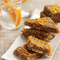 Orange-Cardamom Date Bars with a Nutty Crust Recipe from Food & Wine: The crunchy, almondy topping for these clever bars is loaded with vitamin E. The filling is chewy like caramel and is full of vitamin C from the orange. Nut Recipes, Wine Recipes, Snack Recipes, Dessert Recipes, Dessert Ideas, Healthy Desserts, Fun Desserts, Vegan Sweets, Healthy Treats