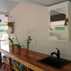 eclectic garage and shed by Island Paint and Decorating