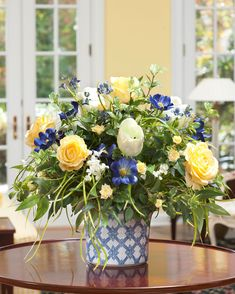 """Charming Rose and Tulip Silk Centerpiece designed in a 6"""" round blue and white porcelain cache pot"""