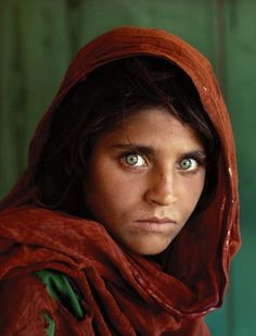 Afghan Girl by Steve McCurry, 1984. Known only as the Afghan girl — her real identity unknown until she was rediscovered in 2002 — Sharbat Gula's face became one of the most iconic National Geographic covers of all time, and a symbol of the struggle of refugees everywhere.