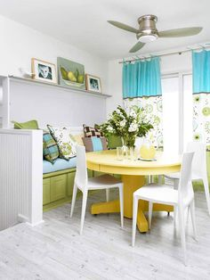 Fabulous ceiling fan and colors in this bright and cheerful dining room!