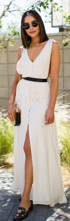 Who made Olivia Culpo's white pleated maxi dress, black sunglasses, and gold shoes?