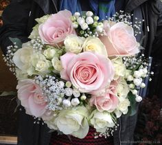 This beautiful bridal bouquet would work for any season. Blush rose and ivory rose with gypsophila bride's bouquet.   Booker Weddings are based in Liverpool, Merseyside and would be happy to quote for Weddings in Liverpool and surrounding areas. We are Wedding Flower specialists and have been specially selected to be one of Interflora's Vera Wang Wedding Florists.