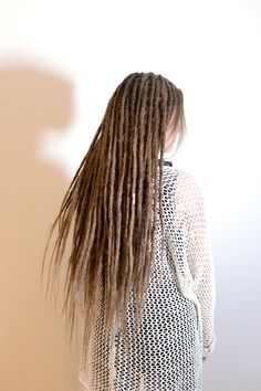 This is Malina, she decided to travel all the way from Norway to get her second set of dreadlocks done. She had fairly short and thin hair so we decided to go for skinny dreadlocks and she wanted some loose hair in the ends. I made dreadlocks on her own hair with human hair extensions for length.