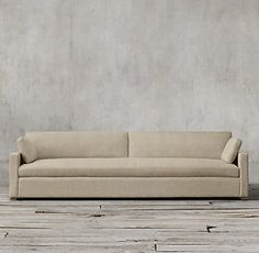 RH's Belgian Track Arm Upholstered Sofa:Our European-inspired take on the classic sofa redefines it for a new age. Low to the ground, deep in profile, and sleekly streamlined for sophisticated appeal, it's a chic, ultra-comfortable twist on tradition.