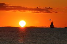 A sailboat floats toward a sunset at Racing Beach in Falmouth, Mass., on Sept. 5, 2015.  Arthur Baggeroer, Your Take