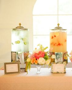 The Beverages: lemon/cucumber infused water and strawberry lemonade.  Floral arrangements elevated on cake pedestals