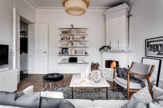 Cosy sitting room with a 'kakelugn' fireplace in an elegant Stockholm apartment (Alexander White).