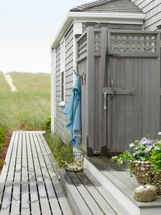 Coastal Decorating Ideas - Beach Cottage Design - Country Living ~ love the outdoor shower AND the carved whale as a door latch for it!