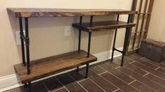 This console table is made of solid wood and pipe, with floating shelves mounted on legs that flow through the entire piece. It provides an modern-rustic landing for your wall-mounted tv, would sit...