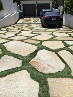 fake grass and stones as DRIVEWAY