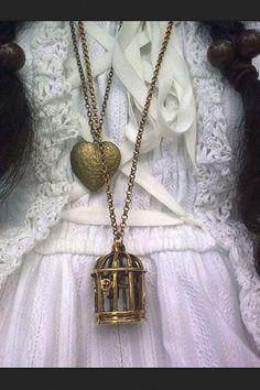 Steampunk.  Funny, I have that birdcage necklace but it's a double strand with a flying bird instead of a heart!