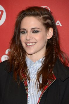 Kristen Stewart added two thin cornrows to her signature side swept part