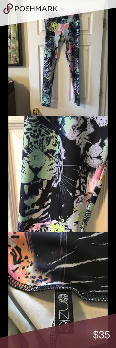 Onzie leggings in Jungle Fever animal print, M/L Onzie graphic leggings in Jungle Fever, M/L. Just about brand new, worn twice. No stains, rips, or pilling. Onzie Pants Leggings