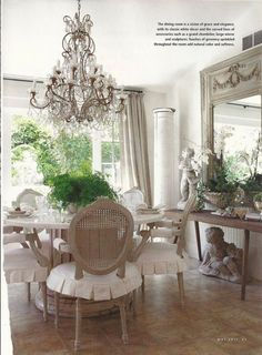 French country dining room looking out onto the garden