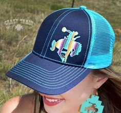 Rodeo Like a Rockstar cap. Blue & Turquoise trucker cap with serape multi colored bucking horse by crazy train. FREE shipping! Buy it now www.ropesandrhinestones.com