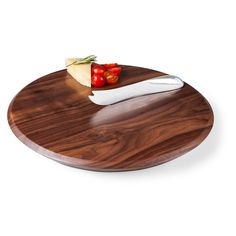 Picnic Time's Solstice is crafted from American black walnut in a beautiful shape that showcases the wood's gorgeous color, grain, and natural beauty. A carved out nook on the top of the board hugs the stainless steel cheese knife and has an imbedded magnet to help keep the knife secured.