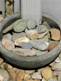 **add in a few holes near the bottom with pex tubes to thruout garden** Iead for unsightly rain down spout. Fill a shallow planter with decorative rocks and have a drain hose from the center hole in the planter out into the garden. Decorative Rock Landscaping, Landscaping With Rocks, Front Yard Landscaping, Decorative Rocks, Landscaping Ideas, Garden Yard Ideas, Lawn And Garden, Garden Projects, Backyard Ideas