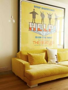 Wow! Yellow much? ... What i love is how deep that couch is (my little legs wouldn't hang off the end of that couch!) and how huge that framed print is.. awesome!