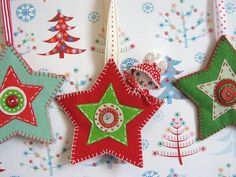 stars with pockets - instead of Christmas - would be lovely as tooth fairy pockets. Or make the star on front the pocket?