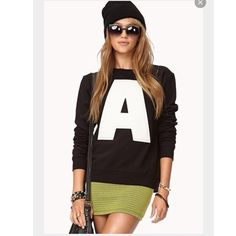 Black Crew Neck Letter A on the front. Got this as a gift from a friend. Doesn't look good on me. PERFECT CONDITION NWOT. Still super soft Forever 21 Sweaters Crew & Scoop Necks