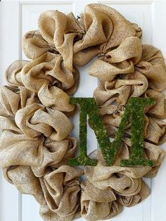 Personalize a burlap wreath with a mossy monogram. Cover a wooden letter with green sheet moss for a fresh spring look. Get the tutorial at Mardi Gras Outlet...