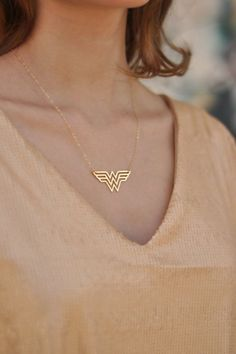 Gold Wonder Woman Necklace , Diana Prince Charm , Wonder Woman Jewelry , Super Hero Jewelry Fun, sophisticated and declarative Classic Double W for Wonder Woman necklace. The pendant is made of brass plated with high quality nickel free gold and matte finish, on gold filled chain. Gold filled is a wonderful alternative for those who love gold but want something more affordable. This adorable necklace would make the greatest gift for you or for the Wonderwoman in your life. Pendant Size:...