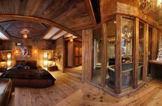 Chalet Lhotse-rustic chic chalet bedroom with attached bath and stone tub