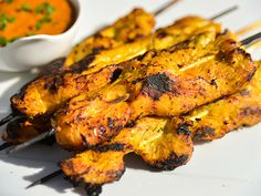 Not Jerky Chicken Satay over the coals.  Serve with peanut sauce (link provided within).  Make the marinade at home and store it in a jar.  2 h. before grilling, marinade in bag. Could also grill some flat bread.
