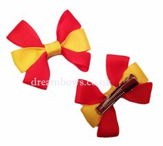 www.dreambows.co.uk Red and yellow grosgrain ribbon hair bows on alligator clips/slides. #red #yellow #redbows #yellowbows #hairbows #girls #dreambows #hairclips #hairslides #prettybows #hairaccessories #cute #pretty #lovebows