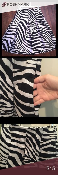 Express zebra print skirt EUC. Express a-line skirt. Black and white zebra print. There is a little pen mark, as shone in the picture. It's so small I had a hard time finding it. Express Skirts Midi