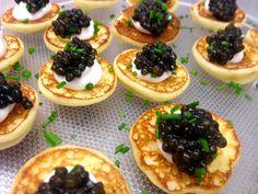 Petrossian Caviar, potato blinis, vodka and chive creme fraiche