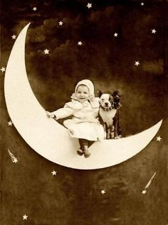 Darling paper moon photo of a toddler and puppy   copyright Libby Hall