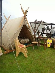 This is a media cache photo so I don't know anything about where it was taken or when.  However, the lack of certain Scadianism in the photo would have me guess one of the European Viking festivals.  I'm pinning it because I like that peg chair in front of the tent.