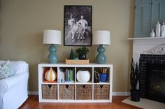 """Expedit behind sofa with baskets for toys and make the """"dead space"""" behind the couch a play nook"""