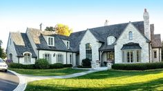 custom stone elevation exterior traditional with stone siding wooden front doors